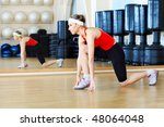 young sporty woman in the gym...   Shutterstock . vector #48064048