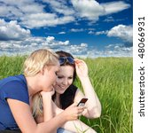 Two Young Women Reading Sms...