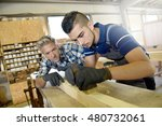 carpenter with apprentice in... | Shutterstock . vector #480732061