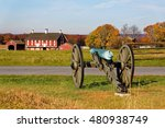A Cannon And A Barn On The...