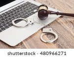 Handcuffs And Gavel On Laptop...