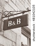 Small photo of Bed and Breakfast Accommodation Sign in Black and White Sepia Tone