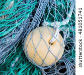 Small photo of Abstract background with a pile of fishing nets ready to be cast overboard for a new days fishing