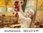 young girl in autumn park with... | Shutterstock . vector #481137199