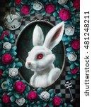 Stock photo alice in wonderland white rabbit from alice in wonderland portrait in oval frame clock key red 481248211
