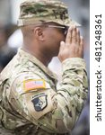 Small photo of NEW YORK MAY 30 2016: Close up of a member of the U.S. Army Airborne Division saluting at the Memorial Day Observance service on the Intrepid Sea, Air & Space Museum.