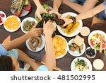 friends cheering with bottles... | Shutterstock . vector #481502995
