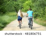 happy couple riding bicycles in ... | Shutterstock . vector #481806751