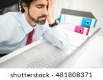 Small photo of Stressed businessman looking at his computer