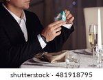 man holding elegant gift box.... | Shutterstock . vector #481918795