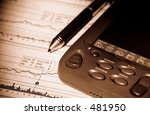 photo of a pda and stock chart... | Shutterstock . vector #481950