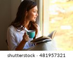 young woman at home sitting...   Shutterstock . vector #481957321