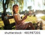young beautiful girl using a... | Shutterstock . vector #481987201