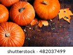 Stock photo pumpkin with pieces over wooden table with copy space 482037499