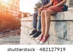 Small photo of Couple in love and romantic relationship. Close up body. Couple of man and woman in the city and sunset background.