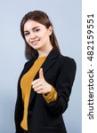 young woman showing thumbs up | Shutterstock . vector #482159551