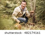 young woman gathers mushrooms... | Shutterstock . vector #482174161