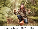 young woman gathers mushrooms... | Shutterstock . vector #482174389