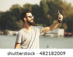 handsome young man with beard...   Shutterstock . vector #482182009