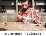 man installing drone propellers.... | Shutterstock . vector #482356801