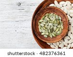 pumpkin seeds in a clay bowl on ... | Shutterstock . vector #482376361