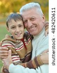 grandfather and grandson in park | Shutterstock . vector #482420611