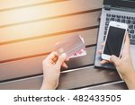 hands holding credit card ... | Shutterstock . vector #482433505
