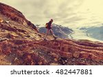 hiking man in the mountains | Shutterstock . vector #482447881