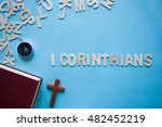 Small photo of Blue background with the Bible book of 1 Corinthians