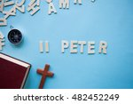 Small photo of Blue background with the Bible book of 2 Peter