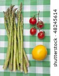 Fresh Asparagus with Lemon and Tomatoes. Healthy Summer Eating. - stock photo