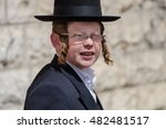Small photo of JERUSALEM, ISRAEL - MARCH 30, 2012: Orthodox Jewish boy walk in jewish quarter. Jerusalem. Israel