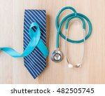 Small photo of Blue ribbon symbolic for prostate cancer awareness and men's health in November month on necktie, doctor's stethoscope