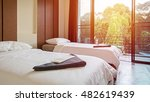 pillows and white bed in bedroom | Shutterstock . vector #482619439