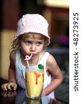 girl drinks a fruit dairy... | Shutterstock . vector #48273925