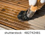 Applying Stain To Decking Area
