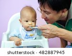 father feeding asian baby boy... | Shutterstock . vector #482887945