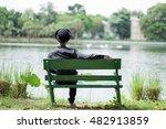 Alone Man Sitting On Bench Nea...