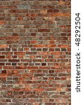 Dirty old red brick wall close up. - stock photo