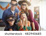 Small photo of Family has fun in Halloween time