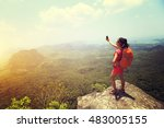 young woman hiker taking photo... | Shutterstock . vector #483005155