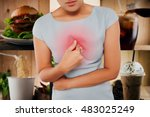 Small photo of Woman with symptomatic acid reflux, On food background