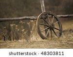 Old Wagon Wheel Near The Fence