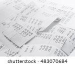cash register receipts in a pile | Shutterstock . vector #483070684