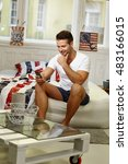 young man sitting on bed  using ...   Shutterstock . vector #483166015