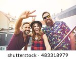 man makes peace sign beside two ... | Shutterstock . vector #483318979