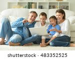 family at home with laptop | Shutterstock . vector #483352525