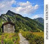 old shelter with path in alpien ... | Shutterstock . vector #483367084