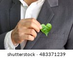 businessman holding a green... | Shutterstock . vector #483371239