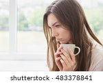 young sad woman with cup of... | Shutterstock . vector #483378841